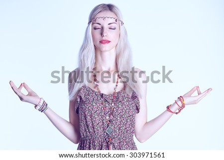 Beauty portrait of boho blonde woman meditates, doing yoga, closed eyes, copyspace. Attractive hippie model girl enjoying relax, harmony. Young happy woman in floral sundress . Romantic style