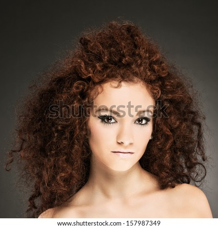 beauty portrait of curly hair woman with smooth makup