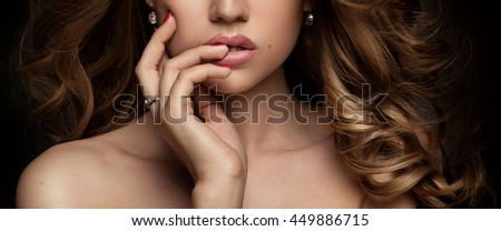 Beauty portrait of elegant young woman. Dark background. Glamour makeup. Closeup photo. Hand on lips. Naked shoulder. #449886715