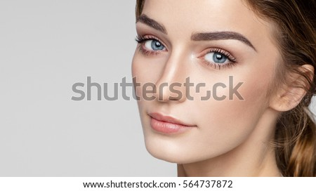 Beauty portrait of female face with natural clean skin