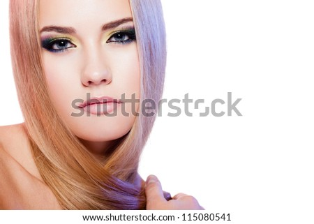 Beauty portrait of female model with colorful makeup on white background
