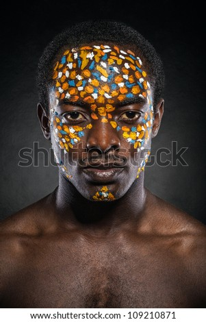 Beauty portrait of handsome ethnic african male with creative make-up. Always more on my portfolio