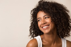 Beauty portrait of happy black woman on light background
