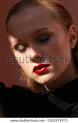 beauty portrait of make up on caucasian blonde fashion model, hollywood make up style, light and shadows on face. red lipstick, studio photography, editorial style