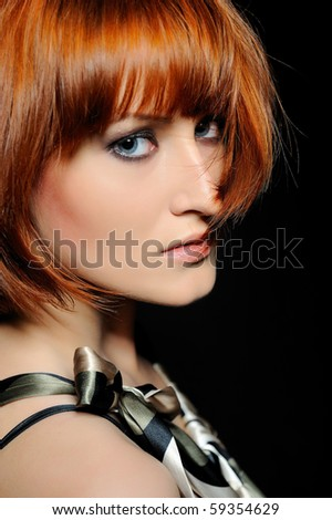 Beauty portrait of pretty woman with short fashion bob hairstyle. black background - stock photo