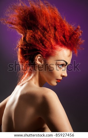 Beauty portrait of woman in profile with red hair and distinctive hairstyle