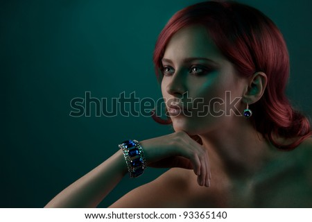 Beauty portrait of woman with beautiful jewelry bracelet with blue stones