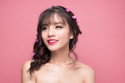 Beauty portrait of young asian woman with perfect make-up. Beautiful model girl with fresh clear skin on pink background.