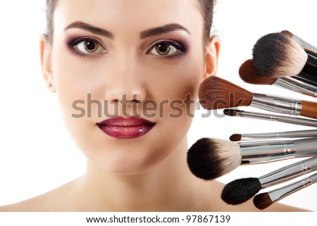 beauty portrait of young beautiful woman with makeup brushes isolated on white background #97867139