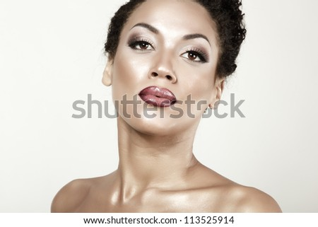 Beauty portrait of young mulatto fresh fashion woman with beautiful makeup, isolated