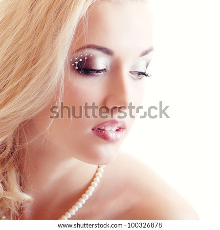 beauty portrait of young woman bride with beautiful makeup and and long blond hair over white background