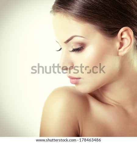 Beauty portrait of young woman with beautiful healthy face in profile, studio shot of attractive girl, toned.