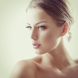 Beauty portrait of young woman with beautiful healthy face, studio shot of attractive girl, toned