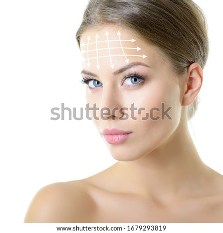 Beauty portrait of young woman with white lines on forehead for cosmetic medical procedures or plastic surgery. Skin care, anti-aging, lifting, rejuvenation concept Stock photo ©