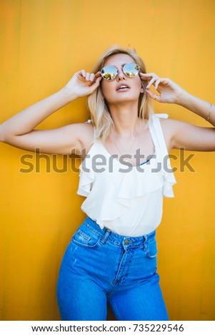 Beauty portrait woman in the city summer near colorful wall