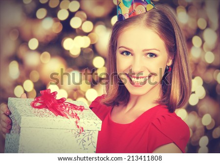 beauty pretty girl in red dress with gift box to birthday or Valentine\'s Day