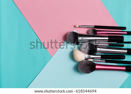 Beauty products, everyday make-up. Cosmetic brushes on bright background, flat lay, top view #618544694