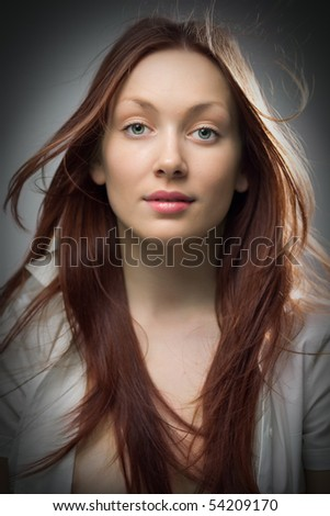 beauty redheaded woman portrait on gray background