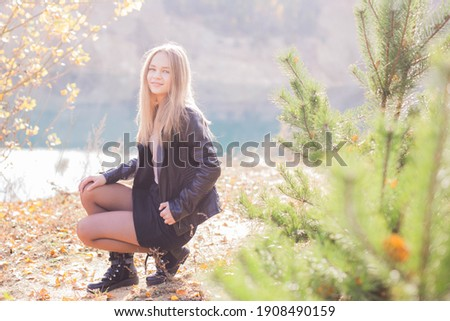 Beauty Romantic Girl outdoor party. Beautiful teen model girl dressed in a short skirt on a field in the sunlight. Blowing out long hair.  The glow of the Sun, Sunshine. Illumination. Tinted Сток-фото ©