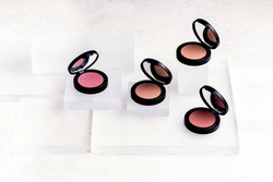 Beauty routine. Makeup palettes with blushes and powder. Minimalist beauty flat lay. Beauty palettes with mirrors. Make up products in minimalist palettes. Pastel blush and powder. Beige, pink colors.