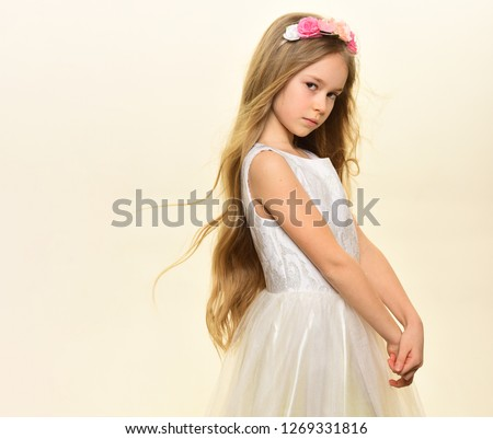 beauty salon. beauty salon services. long hair for little girl in beauty salon, copy space. small girl kid in beauty salon isolated on white. gorgeous and pretty