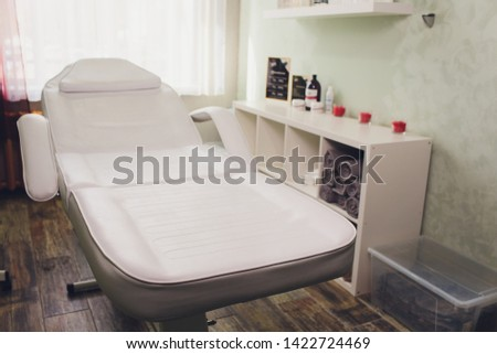 Beauty salon sinks and couches Massage table is in modern beauty shop. #1422724469