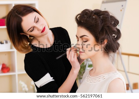 beauty salon, the girl dklayut makeup and styling in the salon, hairdressers and make-up artist, Concept for personal care and beauty