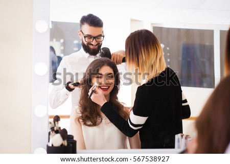 Shutterstock beauty salon, the girl makeup and styling in the salon, hairdressers and make-up artist, Concept for personal care and beauty