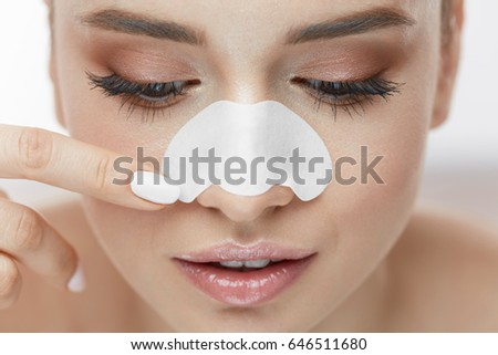 Beauty Skin Care. Beautiful Sexy Girl Applying White Nose Patch On Facial Skin. Closeup Young Female Model With Fresh Natural Makeup And Smooth Soft Skin Using Pore Cleansing Strips. High Resolution