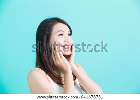 beauty skincare woman look somewhere on green background #641678731