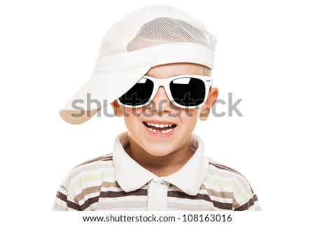 Beauty smiling child boy in sunglasses and cap white isolated