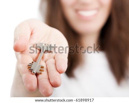 Beauty smiling female human hand holding house key