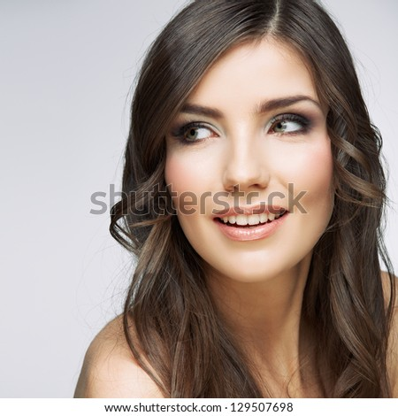 Beauty smiling  woman face close up portrait. Female young model. Studio isolated .