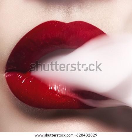 Beauty smoke lips red close up #628432829