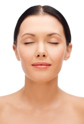 beauty, spa and health concept - relaxed young woman with closed eyes