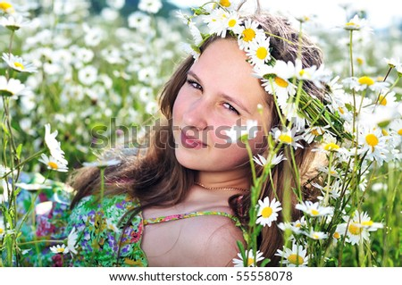beauty spring teen girl with garland from daisies