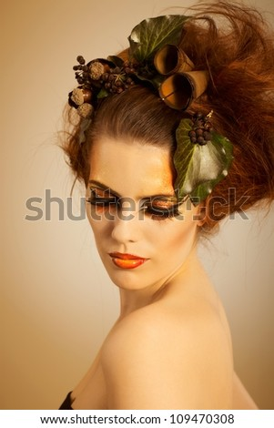 Beauty studio shot redhead woman in autumn makeup