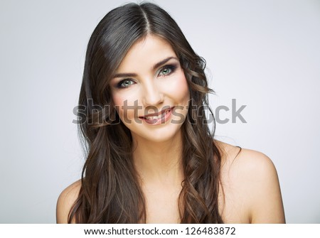 Beauty style female portrait. Smiling woman face close up. - stock photo