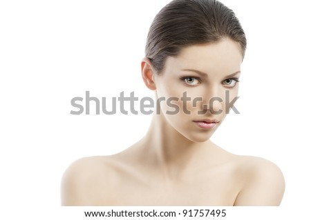 Beauty style portrait of young woman with healthy skin and wet hair . close up on face, she is in front of the camera, looks in to the lens and her face is turned of three-quarters