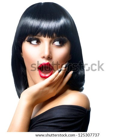 Beauty Surprised Brunette Woman isolated on White background. Beautiful Girl opening Mouth. Emotion. Red Lips and Black Nails. Hairstyle. Makeup
