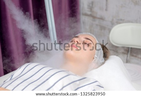 Beauty treatment of young female face, ozone facial steamer #1325823950