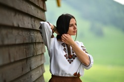 Beauty wearing Romanian blouse called ie