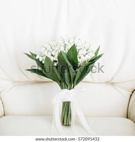 Beauty wedding bouquet of lilies of the valley #572095432