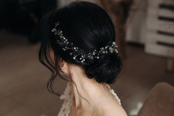 Beauty wedding hairstyle. Bride. Brunette girl with curly hair