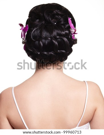 beauty wedding hairstyle with bright flowers and back of the girl