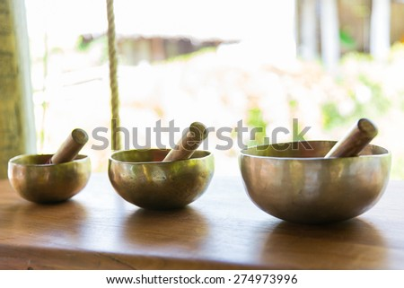 beauty, wellness and therapy concept - set of three pounders on table at hotel spa