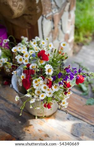 beauty wild flowers in a basket