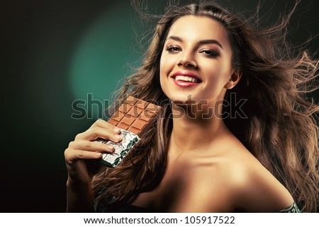 beauty with bar of chocolate