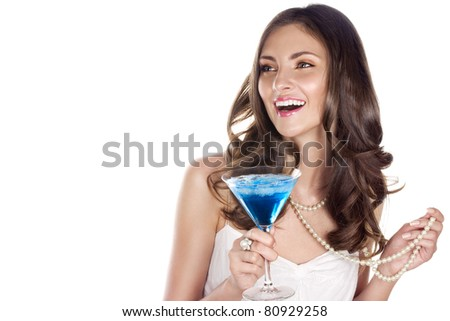 Beauty with blue cocktail at a party. Space for text.