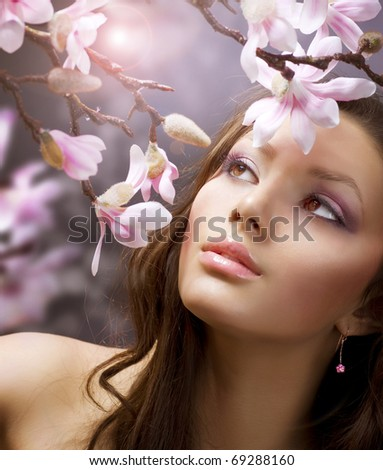 Beauty with flowers.Spring - stock photo